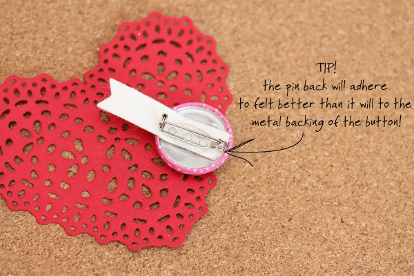Tip for adhering pin back to the button