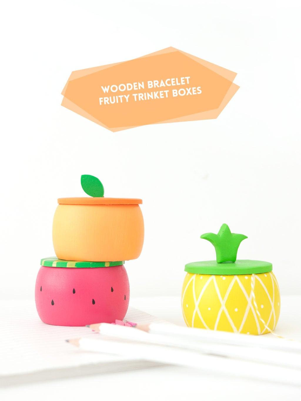 Create DIY Fruity Wooden Bracelet Trinket Boxes with a wooden bracelet and clay to create the perfect desk accessory