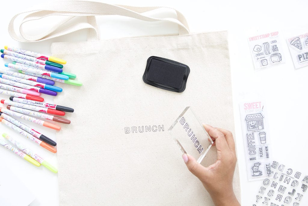 Use a few supplies to create a customized easy stamped canvas tote bag that you can color with fabric markers