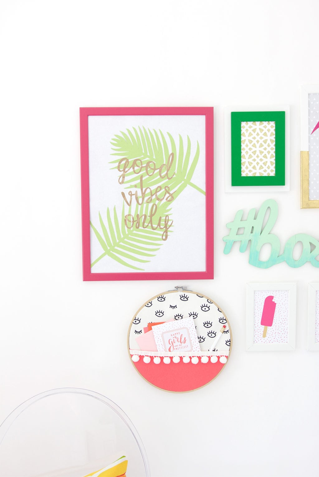 Gallery Walls can be intimidating, which is why I've avoided them until recently. Create your very own colorful Cricut Explore Gallery Wall with just a few cheap frames and some simple craft supplies.