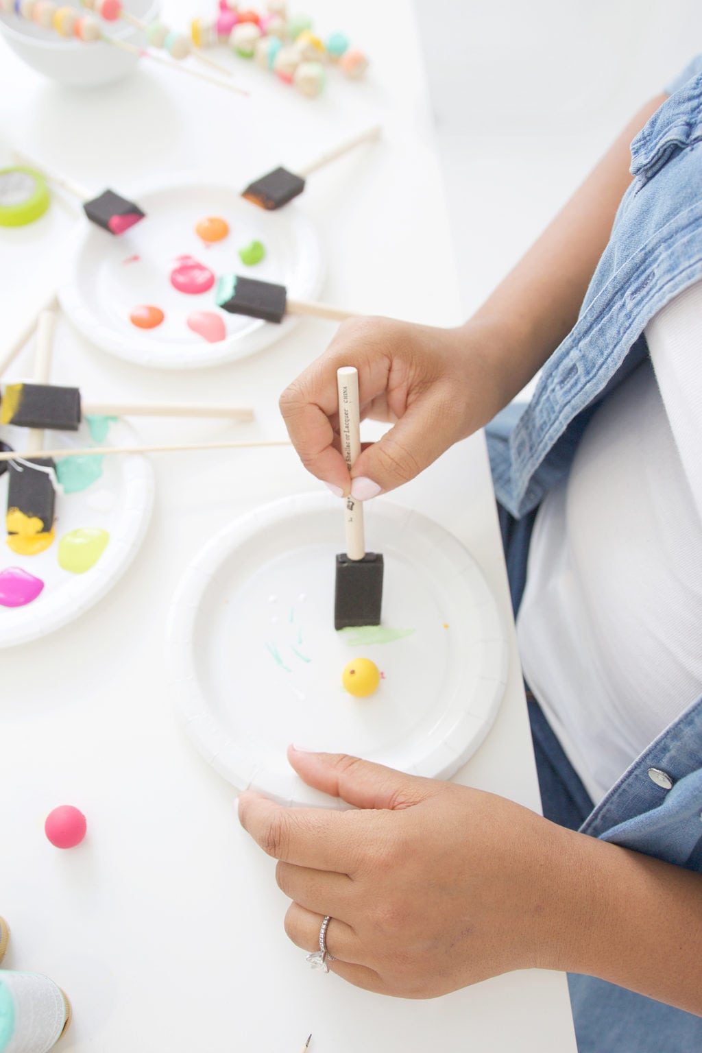 Grab some paint and learn how to paint wooden beads in a variety of different patterns..