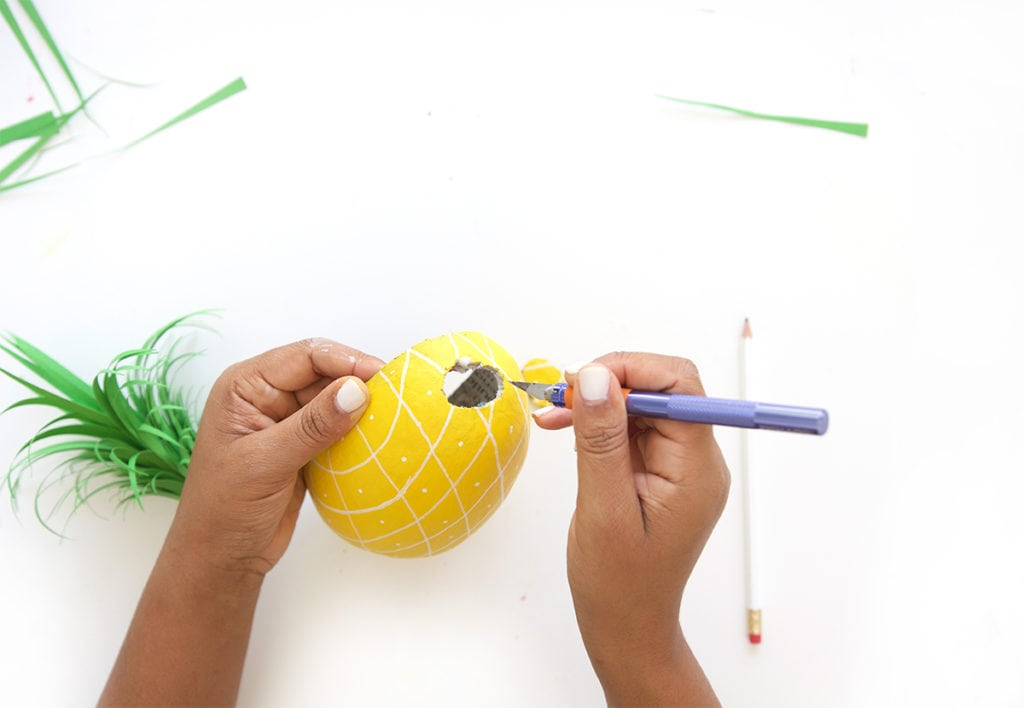Mimic the look of taxidermy with a paper mache egg and some paint. This 3D diy paper mache pineapple wall art is a show stopper and a perfect addition to your gallery wall.