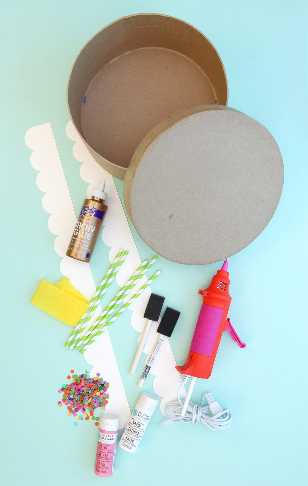 Create your own party out of paper. Use a paper mache box to create a DIY birthday party in a box using simple supplies and fill it up with a few birthday treats