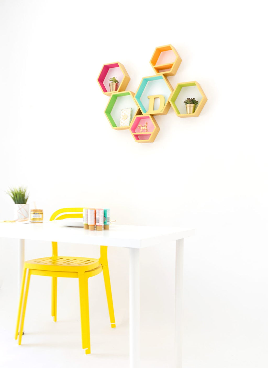 Create these DecoArt Metallic Hexagon Wall Shelves using DecoArt gold metallic paints to add perfect shimmer to your office walls.