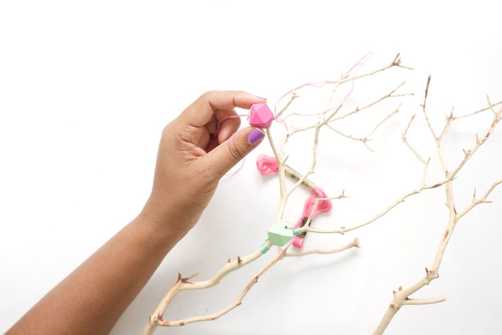 This painted wood bead manzanita branch is a funky take on the beauty of nature! A crafty way to use your painted wooden beads with a few basic supplies.