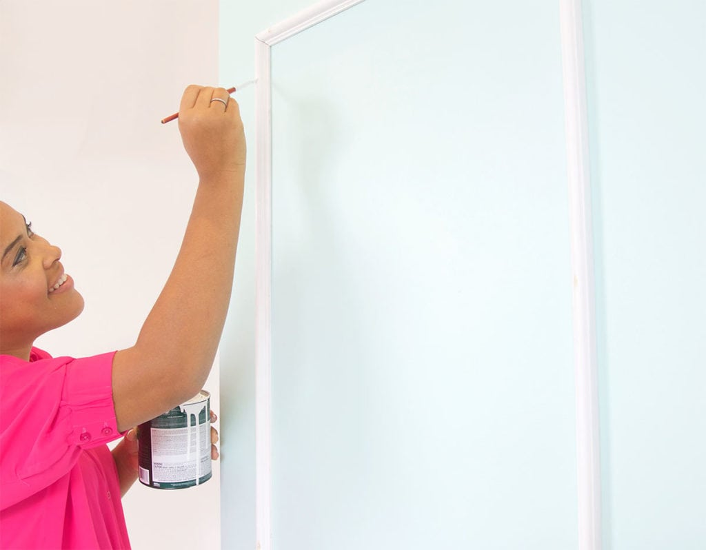 The DIY Stylish Painted Doors with Moulding are a simple and affordable way to upgrade a plain door into something impressive.