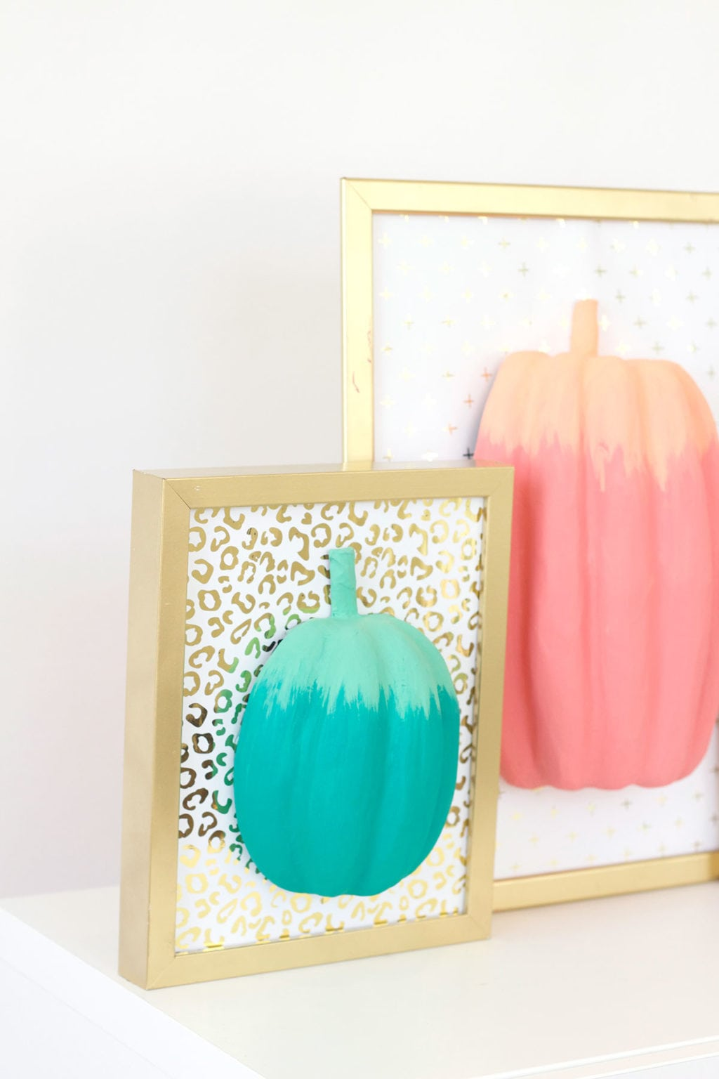 celebrate fall with bold colors and these easy DIY paper pumpkin wall art pieces. All you need is paint!