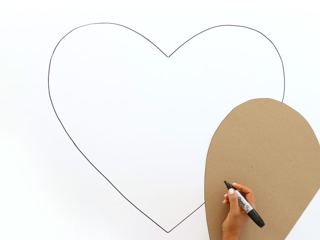 Tracing a heart image onto foam board